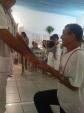 Sr. Edson recebendo o Prêmio das mãos de Nilson